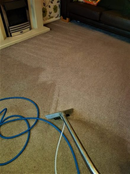 Steam cleaning a lounge carpet